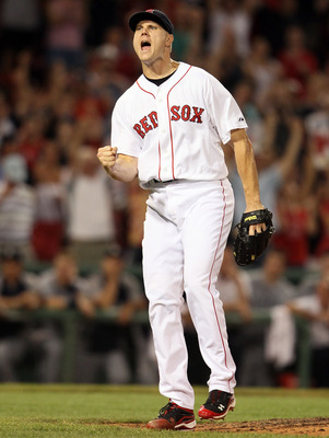 BOSTON, MA - JULY 23:  Jonathan Papelbon #58 of the Boston Red Sox celebrates the win over the Seattle Mariners on July 23, 2011 at Fenway Park in Boston, Massachusetts. The Boston Red Sox defeated the Seattle Mariners 3-1.  (Photo by Elsa/Getty Images)