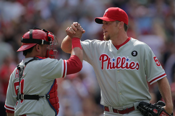 DENVER, CO - AUGUST 03:  Catcher Carlos Ruiz #51 and closer Brad Lidge #54 of the Philadelphia Phillies celebrate their victory over the Colorado Rockies at Coors Field on August 3, 2011 in Denver, Colorado. Lidge earned his first save of the season as th