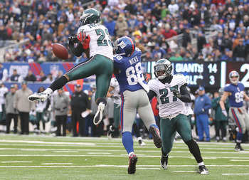 EAST RUTHERFORD, NJ - DECEMBER 19:  Hakeem Nicks #88 of the New York Giants has a pass broken up by Dimitri Patterson #23 of the Philadelphia Eagles during their game on December 19, 2010 at The New Meadowlands Stadium in East Rutherford, New Jersey.  (Ph