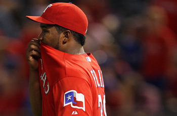 ARLINGTON, TX - JULY 26:  Neftali Feliz #30 of the Texas Rangers reacts after giving up an RBI double against Ben Revere #11 of the Minnesota Twins  at Rangers Ballpark in Arlington on July 26, 2011 in Arlington, Texas.  (Photo by Ronald Martinez/Getty Im