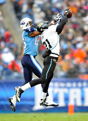 NASHVILLE, TN - DECEMBER 05:  Derek Cox #21 of the Jacksonville Jaguars intercepts a pass intended for Nate Washington #85 of the Tennessee Titans  during the first half at LP Field on December 5, 2010 in Nashville, Tennessee.  (Photo by Grant Halverson/G