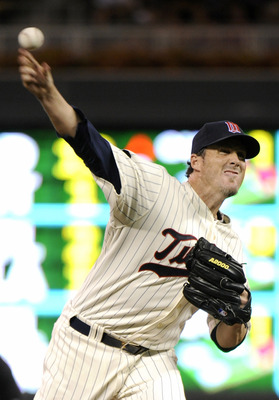 MINNEAPOLIS, MN - AUGUST 6: Joe Nathan #36 of the Minnesota Twins delivers a pitch against the Chicago White Sox in the ninth inning on August 6, 2011 at Target Field in Minneapolis, Minnesota. The White Sox defeated the Twins 6-1. (Photo by Hannah Foslie