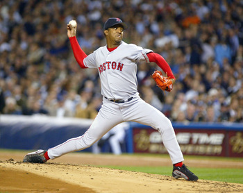 BRONX, NY - OCTOBER 16:  Pedro Martinez #45 of the Boston Red Sox pitches against the New York Yankees in the first inning during game 7 of the American League Championship Series on October 16, 2003 at Yankee Stadium in the Bronx, New York.  (Photo by Al