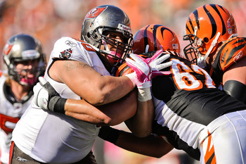 CINCINNATI, OH - OCTOBER 10: Defensive tackle Roy Miller #90 of the Tampa Bay Buccaneers fights through a block against the Cincinnati Bengals at Paul Brown Stadium on October 10, 2010 in Cincinnati, Ohio. (Photo by Jamie Sabau/Getty Images)