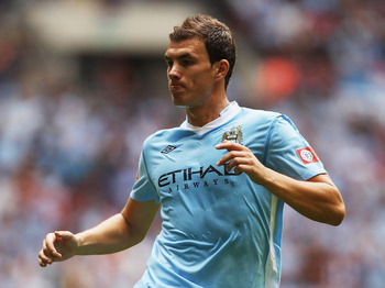 LONDON, ENGLAND - AUGUST 07:  Edin Dzeko of Manchester City in action during the FA Community Shield match sponsored by McDonald's between Manchester City and Manchester United at Wembley Stadium on August 7, 2011 in London, England.  (Photo by Ian Walton