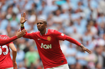 LONDON, ENGLAND - AUGUST 07:  Ashley Young of Manchester United celebrates with goalscorer Chris Smalling during the FA Community Shield match sponsored by McDonald's between Manchester City and Manchester United at Wembley Stadium on August 7, 2011 in Lo