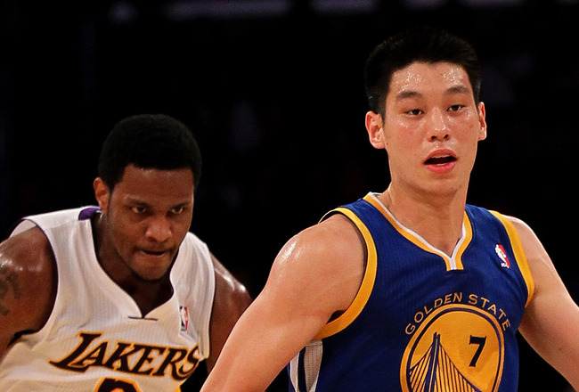 LOS ANGELES, CA - NOVEMBER 21:  Jeremy Lin #7 of the Golden State Warriors drives ahead of Devin Ebanks #3 of the Los Angeles Lakers at Staples Center on November 21, 2010 in Los Angeles, California.   The Lakers won 117-89. NOTE TO USER: User expressly a