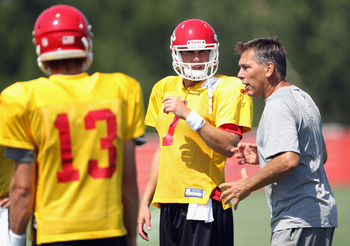 SAINT JOSEPH, MO - JULY 31:  Quarterbacks coach Jim Zorn instructs Ricky Stanzi #13 and Matt Cassel #7 during Kansas City Chiefs Training Camp on July 31, 2011 in Saint Joseph, Missouri.  (Photo by Jamie Squire/Getty Images)