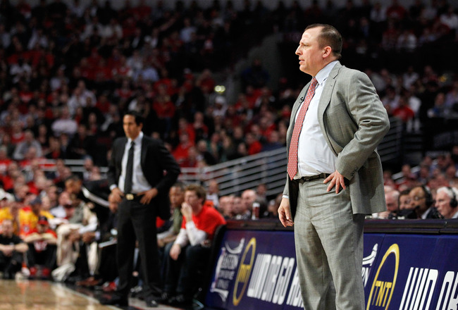 CHICAGO, IL - MAY 18:  Head coach Tom Thibodeau (R) of the Chicago Bulls looks on as head coach Erik Spoelstra of the Miami Heat stands in the background in Game Two of the Eastern Conference Finals during the 2011 NBA Playoffs on May 18, 2011 at the Unit