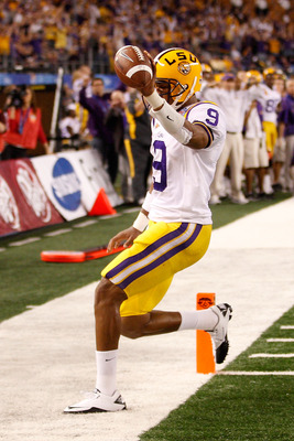 ARLINGTON, TX - JANUARY 07:  Jordan Jefferson #9 of the Louisiana State University Tigers celebrates after scoring a touchdown during the game against the Texas A&M Aggies during the AT&T Cotton Bowl at Cowboys Stadium on January 7, 2011 in Arlington, Tex