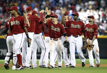 PHOENIX, AZ - AUGUST 07:  Collin Cowgill #4 (C) of the Arizona Diamondbacks celebrates with teammates after defeating the Los Angeles Dodgers in the Major League Baseball game at Chase Field on August 7, 2011 in Phoenix, Arizona. The Diamondbacks defeated