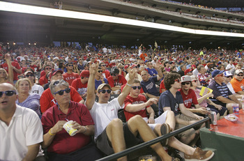 ARLINGTON, TX - JUNE 21: Texas Rangers fans celebrate winning the Guinness World Book of Records for wearing sunglasses at night for ten minutes at night during the game against the Houston Astros at Rangers Ballpark in Arlington on June 21, 2011 in Arlin