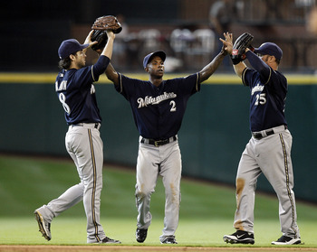 HOUSTON - AUGUST 07:  Center fielder Nyjer Morgan #2 high fives left fielder Ryan Braun #8 and Mark Kotsay #25 after the final out as the Milwaukee Brewers defeated the Houston Astros 7-3 at Minute Maid Park on August 7, 2011 in Houston, Texas.  (Photo by