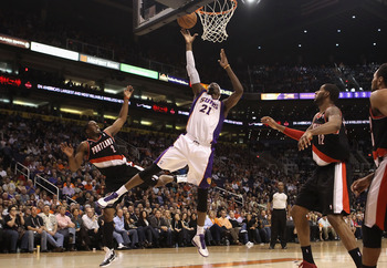 PHOENIX, AZ - JANUARY 14:  Hakim Warrick #21 of the Phoenix Suns puts up a shot past Wesley Matthews #2 of the Portland Trail Blazers during the NBA game at US Airways Center on January 14, 2011 in Phoenix, Arizona.  The Suns defeated the 115-111.  NOTE T
