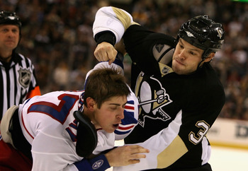 PITTSBURGH - NOVEMBER 17:  Jarkko Ruutu #37 of the Pittsburgh Penguins fights with Brandon Dubinsky #17 of the New York Rangers during the second period of the NHL game at Mellon Arena on November 17, 2007 in Pittsburgh, Pennsylvania.  (Photo by Christian