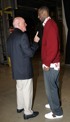 MIAMI - DECEMBER 25: Legendary coach and Basketball Hall of Famer Dr. Jack Ramsay has a few words of advice for Guard Kobe Bryant #8 of the Los Angeles Lakers on his arrival before their game against the Miami Heat on December 25, 2005 at the American Air