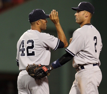 BOSTON, MA - AUGUST 05:  Mariano Rivera #42 and Derek Jeter #3 of the New York Yankees celebrate the win over the Boston Red Sox on August 5, 2011 at Fenway Park in Boston, Massachusetts. The New York Yankees defeated the Boston Red Sox 3-2.  (Photo by El