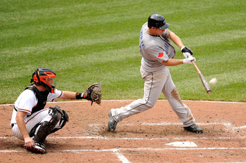 BALTIMORE, MD - AUGUST 07:  Brett Lawrie #13 of the Toronto Blue Jays hits his first career home run in the sixth inning against the Baltimore Orioles at Oriole Park at Camden Yards on August 7, 2011 in Baltimore, Maryland.  (Photo by Greg Fiume/Getty Ima