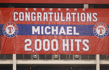 ARLINGTON, TX - AUGUST 07:  A banner is unveiled after Michael Young's 2,000 career hit during play against the Cleveland Indians  at Rangers Ballpark in Arlington on August 7, 2011 in Arlington, Texas.  (Photo by Ronald Martinez/Getty Images)