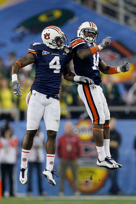 GLENDALE, AZ - JANUARY 10:  Zac Etheridge #4 and Demond Washington #14 of the Auburn Tigers celebrate against the Oregon Ducks during the Tostitos BCS National Championship Game at University of Phoenix Stadium on January 10, 2011 in Glendale, Arizona.  (