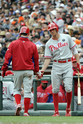SAN FRANCISCO, CA - AUGUST 7: Roy Oswalt #44 of the Philadelphia Phillies celebrates with Hunter Pence #3 after scoring on a Chase Utley RBI single against the San Francisco Giants in the third inning during a MLB baseball game at AT&T Park August 7, 2011