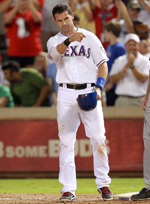 ARLINGTON, TX - AUGUST 07:  Michael Young #10 of the Texas Rangers reacts after hitting a single for his 2000th career hit during play against the Cleveland Indians  at Rangers Ballpark in Arlington on August 7, 2011 in Arlington, Texas.  (Photo by Ronald