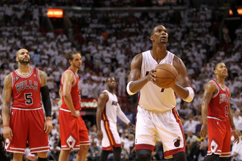 MIAMI, FL - MAY 24:  Chris Bosh #1 of the Miami Heat gets set to attempt a technical free throw attempt against Carlos Boozer #5, Joakim Noah #13 and Derrick Rose #1 of the Chicago Bulls in Game Four of the Eastern Conference Finals during the 2011 NBA Pl