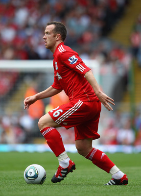 LIVERPOOL, ENGLAND - AUGUST 06: Charlie Adam of Liverpool in action during the pre season friendly match between Liverpool and Valencia at Anfield on August 6, 2011 in Liverpool, England.  (Photo by Clive Brunskill/Getty Images)