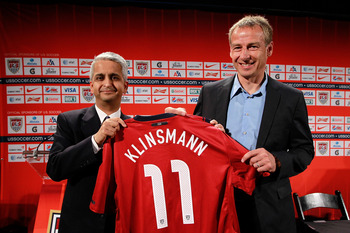 NEW YORK, NY - AUGUST 01:  U.S. Soccer President (L) Sunil Gulati officially announces (R) Jurgen Klinsmann as the new head coach of the U.S. Men's National Team during a press conference at NikeTown on August 1, 2011 in New York City.  (Photo by Chris Tr