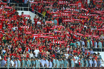 GUANGZHOU, CHINA - JULY 13:  Chinese fans of Liverpool celebrate winning after the pre-season friendly match between Guangdong Sunray Cave and Liverpool at Guangdong Provincial People's Stadium on July 13, 2011 in Guangzhou, China.  (Photo by Feng Li/Gett
