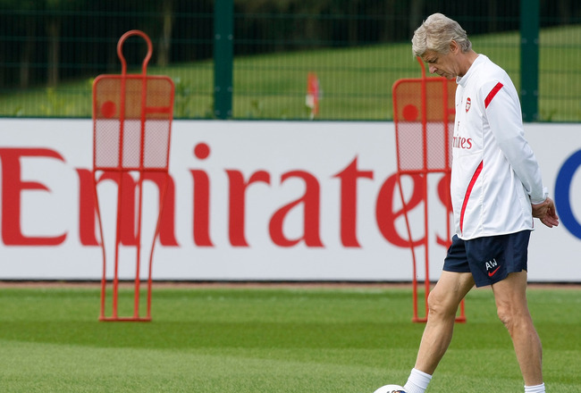 ST ALBANS, ENGLAND - AUGUST 5: Manager of Arsenal Arsene Wenger  dribbles a ball a training session at London Colney on August 5, 2011 in St Albans, England. (Photo by Tom Dulat/Getty Images)