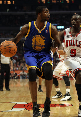 CHICAGO, IL - NOVEMBER 11: Dorell Wright #1 of the Golden State Warriors moves against Loul Deng #9 of the Chicago Bulls at the United Center on November 11, 2010 in Chicago, Illinois. The Bulls defeated the Warriors 120-90. NOTE TO USER: User expressly a