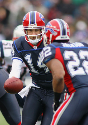 ORCHARD PARK, NY - DECEMBER 26:  Ryan Fitzpatrick #14  of the Buffalo Bills hands off to Fred Jackson #22 in a match against the New England Patriots at Ralph Wilson Stadium on December 26, 2010 in Orchard Park, New York.  (Photo by Rick Stewart/Getty Ima