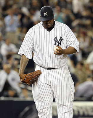 NEW YORK, NY - JULY 26:  CC Sabathia #52 of the New York Yankees looks on after surrendering a seventh inning single to Brendan Ryan (not pictured) of the Seattle Mariners on July 26, 2011 at Yankee Stadium in the Bronx borough of New York City. Ryan's hi
