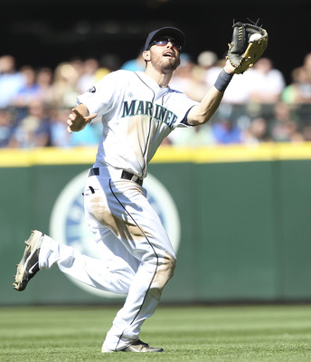 SEATTLE - AUGUST 03:  Second baseman Dustin Ackley #13 of the Seattle Mariners catches a pop up by Adam Rosales of the Oakland Athletics for the second out of the ninth inning at Safeco Field on August 3, 2011 in Seattle, Washington. The Mariners defeated