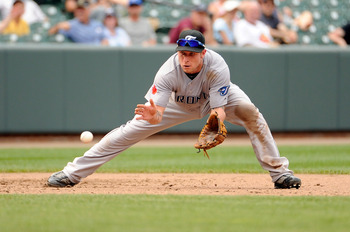 BALTIMORE, MD - AUGUST 07:  Brett Lawrie #13 of the Toronto Blue Jays fields a ground ball during the game against the Baltimore Orioles at Oriole Park at Camden Yards on August 7, 2011 in Baltimore, Maryland.  (Photo by Greg Fiume/Getty Images)