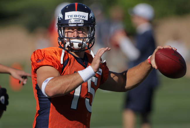ENGLEWOOD, CO - JULY 28:  Quarterback Tim Tebow #15 of the Denver Broncos throws a pass during training camp at the Paul D. Bowlen Memorial Broncos Centre at Dove Valley on July 28, 2011 in Englewood, Colorado.  (Photo by Doug Pensinger/Getty Images)