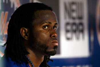 NEW YORK, NY - AUGUST 05:  Jose Reyes #7 of the New York Mets looks on from the dugout during the game against the Atlanta Braves at Citi Field on August 5, 2011 in the Flushing neighborhood of the Queens borough of New York City.  (Photo by Chris Trotman
