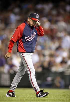DENVER, CO - AUGUST 05: Manager Davey Johnson of the Washington Nationals walks back to the dugout during their game against the Colorado Rockies at Coors Field August 5, 2011 in Denver, Colorado. The Washington Nationals won the game 5-3. (Photo by Marc