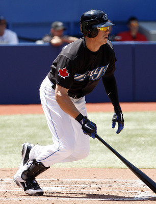 TORONTO, CANADA - JULY 30:  Colby Rasmus #28 of the Toronto Blue Jays grounds to first during MLB action at the Rogers Centre July 30, 2011 in Toronto, Ontario, Canada. (Photo by Abelimages/Getty Images)