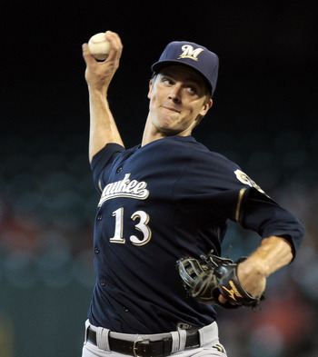 HOUSTON - AUGUST 07: Pitcher Zack Greinke #13 of the Milwaukee Brewers throws against the Houston Astros at Minute Maid Park on August 7, 2011 in Houston, Texas. (Photo by Bob Levey/Getty Images)