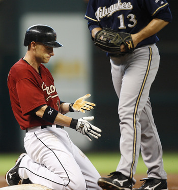 HOUSTON, TX - AUGUST 07: Clint Barmes #12 of the Houston Astros is tagged out by pitcher Zack Greinke #13 of the Milwaukee Brewers after trying to steal third base in the third inning at Minute Maid Park on August 7, 2011 in Houston, Texas. (Photo by Bob