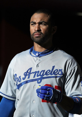PHOENIX, AZ - AUGUST 06:  Matt Kemp #27 of the Los Angeles Dodgers walks in the dugout before the Major League Baseball game against the Arizona Diamondbacks at Chase Field on August 6, 2011 in Phoenix, Arizona. The Dodgers defeated the Diamondbacks 5-3.