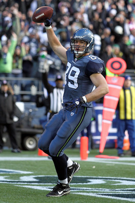SEATTLE, WA - JANUARY 08:  Tight end John Carlson #89 of the Seattle Seahawks celebrates his 11-yard touchdown reception in the first quarter against the New Orleans Saints during the 2011 NFC wild-card playoff game at Qwest Field on January 8, 2011 in Se