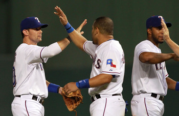 ARLINGTON, TX - AUGUST 07:  Michael Young #10 of the Texas Rangers celebrates a win against the Cleveland Indians at Rangers Ballpark in Arlington on August 7, 2011 in Arlington, Texas.  (Photo by Ronald Martinez/Getty Images)