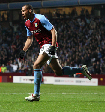 BIRMINGHAM, UNITED KINGDOM - FEBRUARY 18:  John Carew of Aston Villa celebrates after his goal during the UEFA Cup match between Aston Villa and CSKA Moscow at Villa Park on February 18, 2009 in Birmingham, England.  (Photo by Ross Kinnaird/Getty Images)