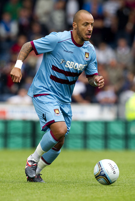 WYCOMBE, ENGLAND - JULY 23: Julien Faubert of West Ham in action during the Pre Season Friendly match betwen Wycombe Wanderers and West Ham United at Adams Parks on July 23, 2011 in Wycombe, England.  (Photo by Ben Hoskins/Getty Images)