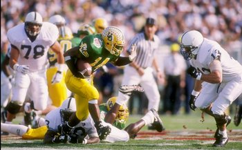 2 Jan 1995:  Tailback Ricky Whittle of the Oregon Ducks tries to break a tackle during the Rose Bowl against the Penn State Nittany Lions at the Rose Bowl in Pasadena, California.  Penn State won the game 38-20. Mandatory Credit: Mike Powell  /Allsport
