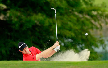 JOHNS CREEK, GA - AUGUST 08:  Justin Rose of England hits out of the sand during a practice round prior to the start of the 93rd PGA Championship at the Atlanta Athletic Club on August 8, 2011 in Johns Creek, Georgia.  (Photo by Kevin C. Cox/Getty Images)
