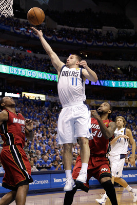 DALLAS, TX - JUNE 07:  Jose Juan Barea #11 of the Dallas Mavericks drives for a shot attempt against Mario Chalmers #15 and Udonis Haslem #40 of the Miami Heat in Game Four of the 2011 NBA Finals at American Airlines Center on June 7, 2011 in Dallas, Texa